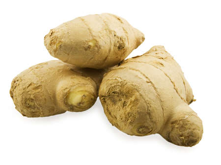 Ginger roots on white background