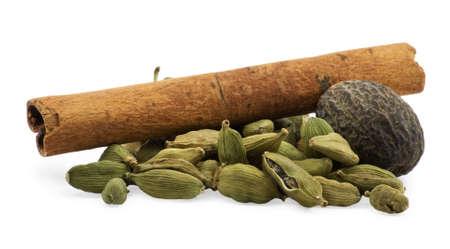 Nutmeg, cardamom, cinnamon on white background