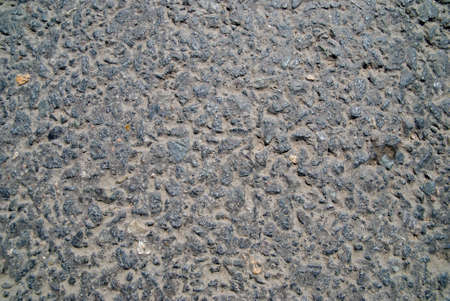 Road asphalt with large impregnations of a granite Stock Photo
