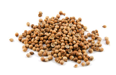 Coriander seeds on white background