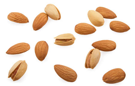 Almonds and pistachios are scattered on a white background Stock Photo