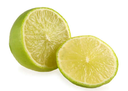 The cut lime on white background