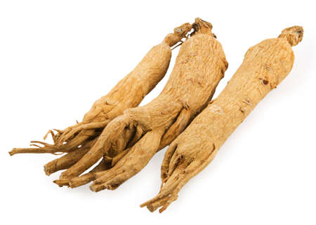Three ginseg roots on white background
