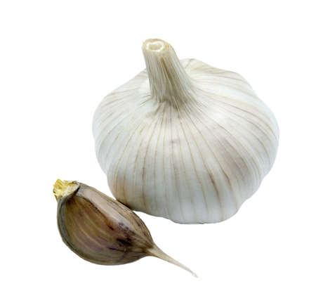 Head of garlic and one seed of garlic