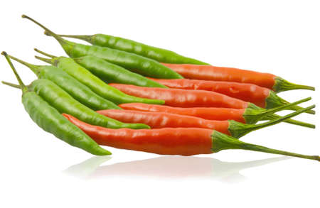 Red and green cayenne pepper  lie opposite each other