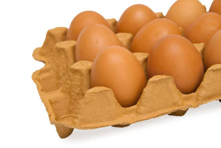 Eggs in cardboard on white background