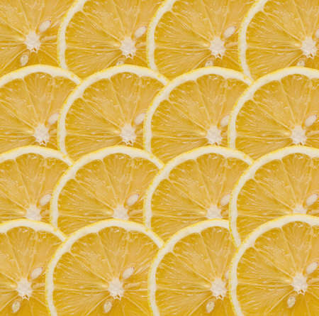 Background from segments yellow lemons Stock Photo