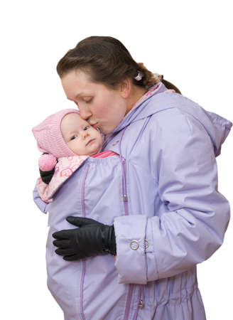 Mum in sling-jacket with baby on white background Stock Photo
