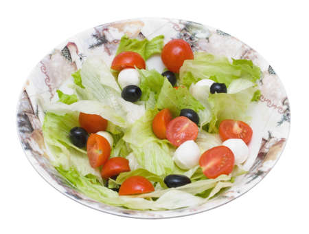 Salad with  Iceberg, olives, �tomatos cherry and cheese Mozzarella on white background