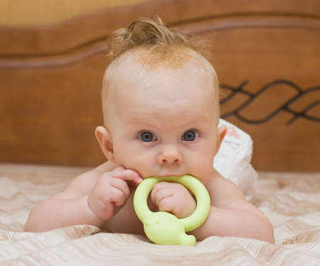 teether: Baby gnaw green latex teether Stock Photo