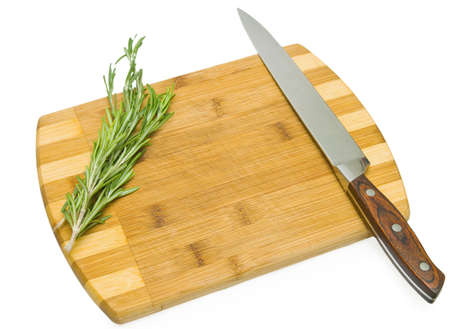 rosemary on the cutting board with the knife Stock Photo