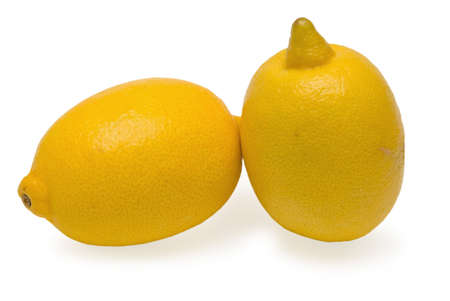 Two yellow lemons lie nearby with each other on white background