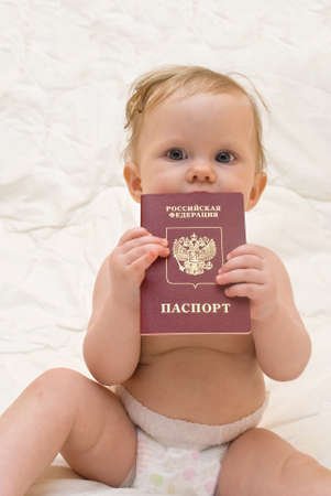 Infant keep in hand russian passport Stock Photo