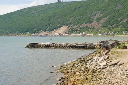 Old pier in Magadan, Russia Stock Photo