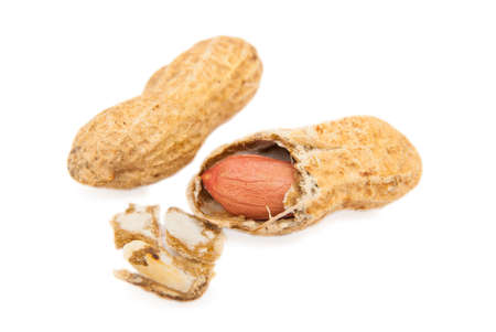 peanut with cracked shell on white background Stock Photo