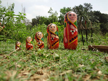wooden doll: Cute wooden doll standing side by side. Stock Photo