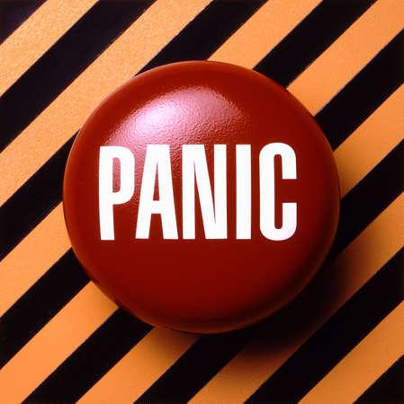 Panic button on orange and black background