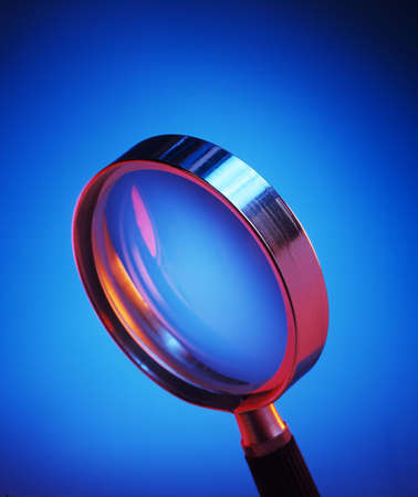 Magnifying glass on blue Banco de Imagens - 2176352