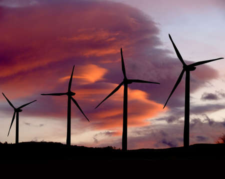 Wind farm propellers at sunset