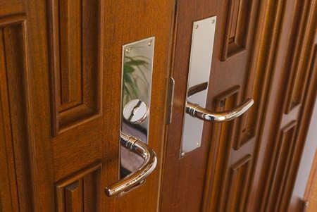 deadbolt: Angled door handles on mahogany
