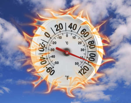 Burning thermometer on blue sky