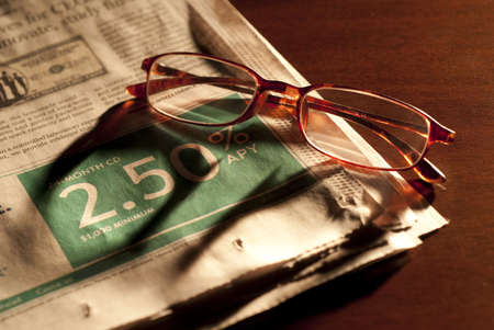 glasses and business section of newspaper photo