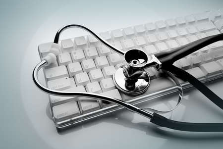 Keyboard and stethoscope in green Banco de Imagens