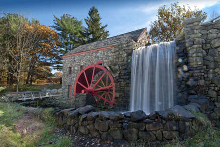 grist mill: old grist mill with water wheel used to power grinding stones