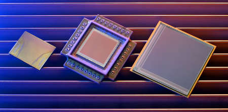 3 computer chips photographed on hi tech colorful background