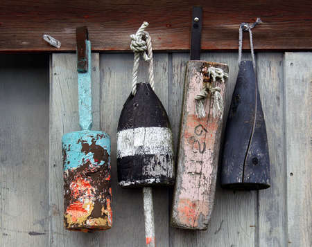 lobster boat:          Lobster buoys on weathered gray wood fishing shack