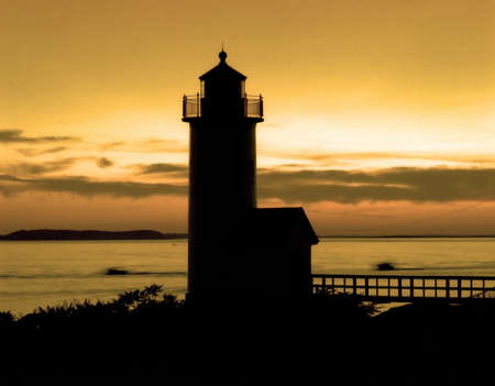 Lighthouse after sunset in tones of orange and yellows Stock Photo - 6502283