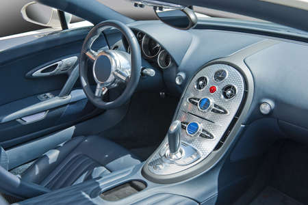 front view: Sports car interior in blues and turned aluminum console