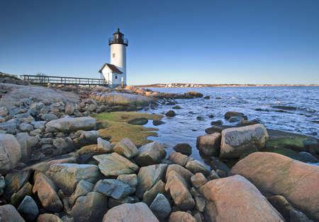 Lighthouse at dawn off Anisquam, Massachusetts Stock Photo - 6974555