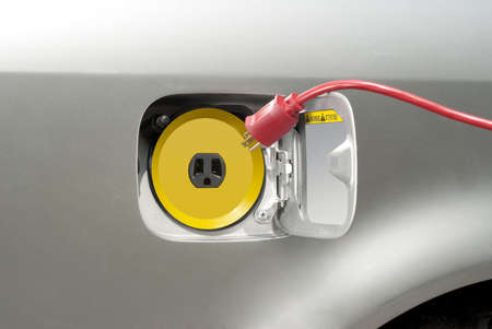 mpg: Electric car about to be recharged with regular household current Stock Photo
