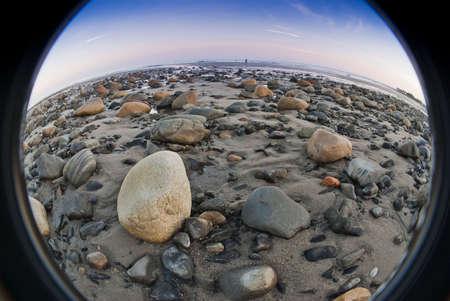 Fisheye view of low tide on rocky beach