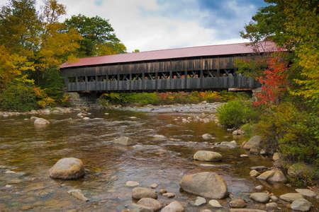 covered bridge': New England covered bridge during the fall season
