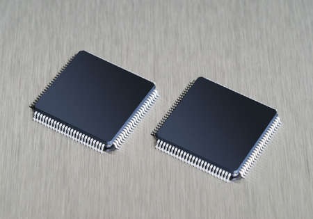 intel: Two computer chips on stainless steel background