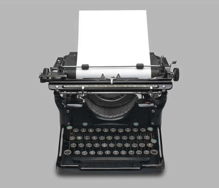 correspond: old fashioned vintage typewriter with a blank sheet of paper  Stock Photo