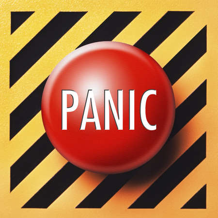 Panic button in red on orange and black background Stock Photo - 8281098