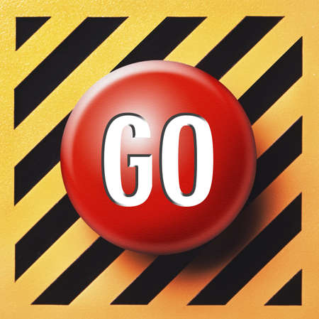 Red GO button on yellow and black panel photo