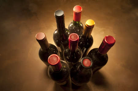 Wine bottles in perspective on warm background photo