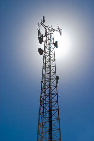 Cell tower and radio antenna back lit by sun Stock Photo - 8910309
