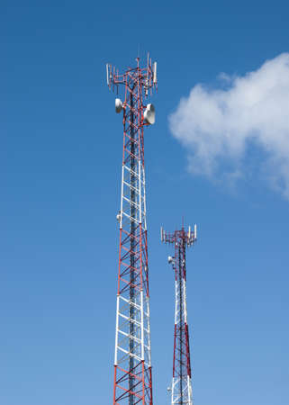 Cell tower and radio antenna against a blue sky Stock Photo - 8910308