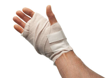 Injured male hand wrapped with bandage Stock Photo