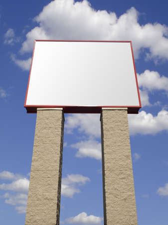 Store advertising sign in stone over cloudy sky, isolated  Stock Photo - 9117321