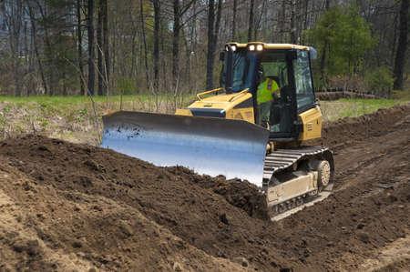 Bulldozer pushing dirt on construction site Stock Photo - 9461444