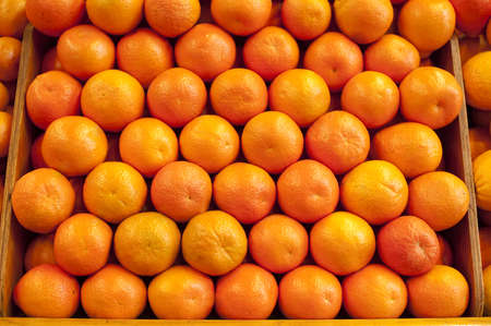 bunched: Fresh oranges bunched together at a farm stand