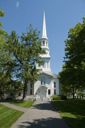 Old white new england church located on Cape Cod, MA photo