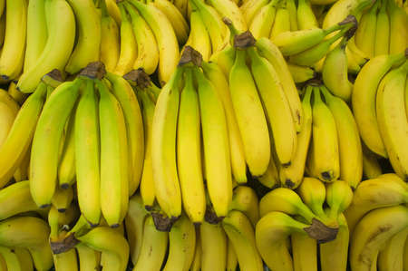 Bunch of bananas in a produce farm stand Stock Photo