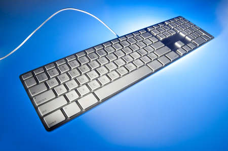 Keyboard in perspective shot on back lit blue background Stock Photo - 9940140